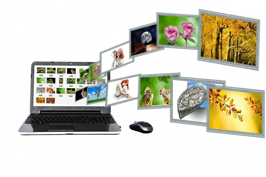 image of a laptop with pictures flying out of the screen